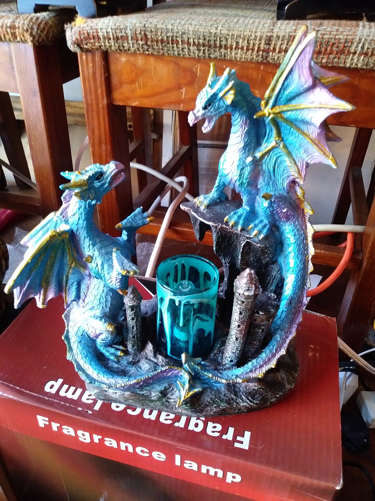 A beautifully detailed electric double dragon oil wamer, blue, made of polyresin