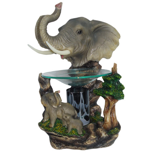 A beautifully detailed electric elephant oil wamer, made of polyresin