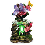 A gorgeous butterfly oil warmer, a very detailed paint and colors
