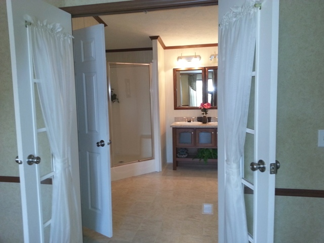 French doors lead to master bath