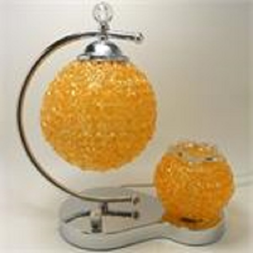 A uniquely designed Oil warmer, double globe, orange tart burner, 71or