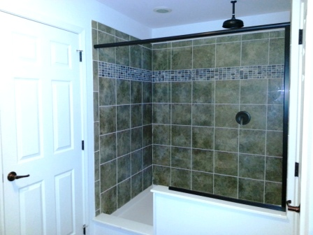 Walk-in tile shower in master bath.