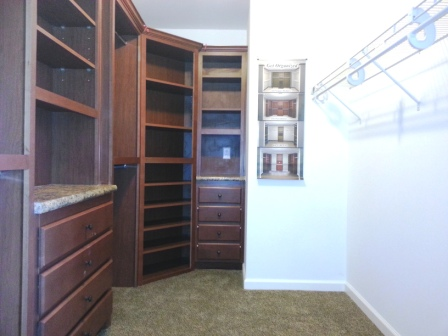 Storage in master bedroom closet.