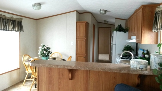 Wrap around counter separates living area