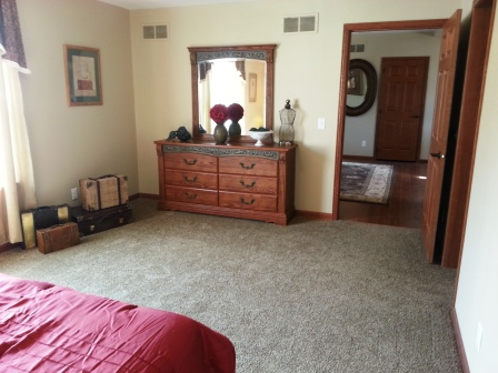 Master bedroom is off the family room.