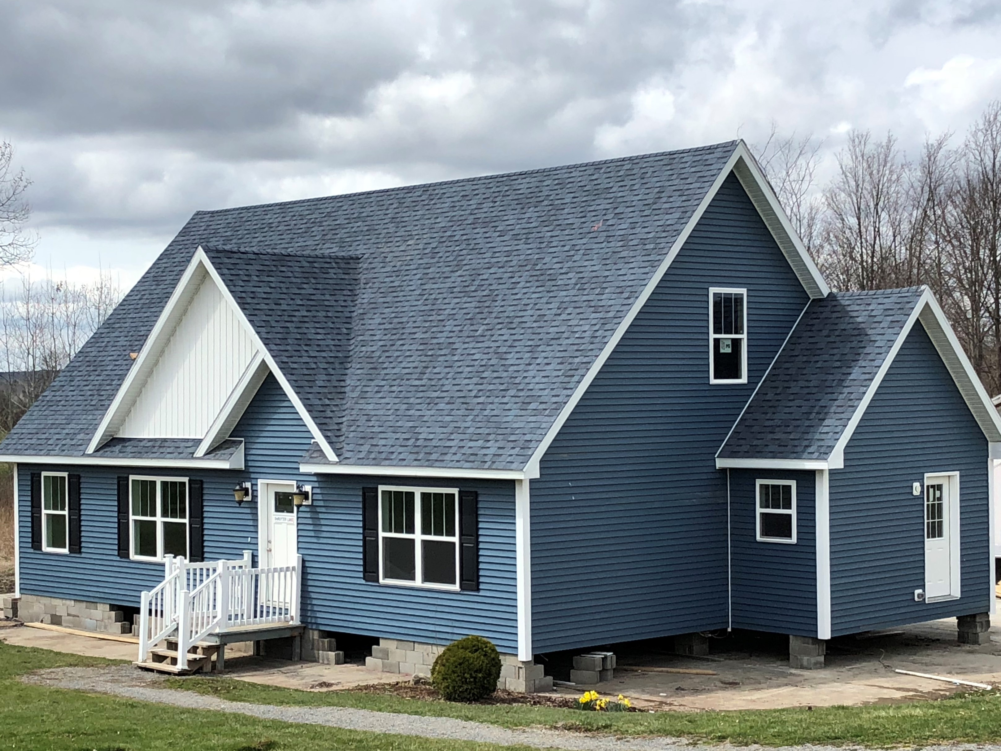 Shown With Optional 12/12 Roof    The Cape Package