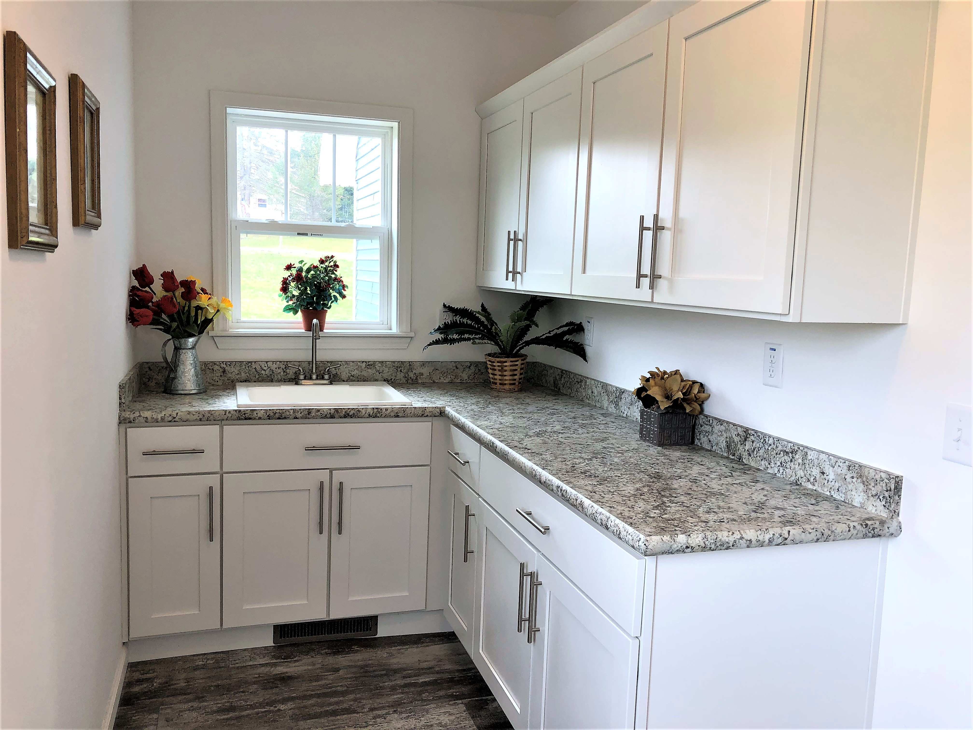 This Optional Utility is Shown With Optional White Cabinets