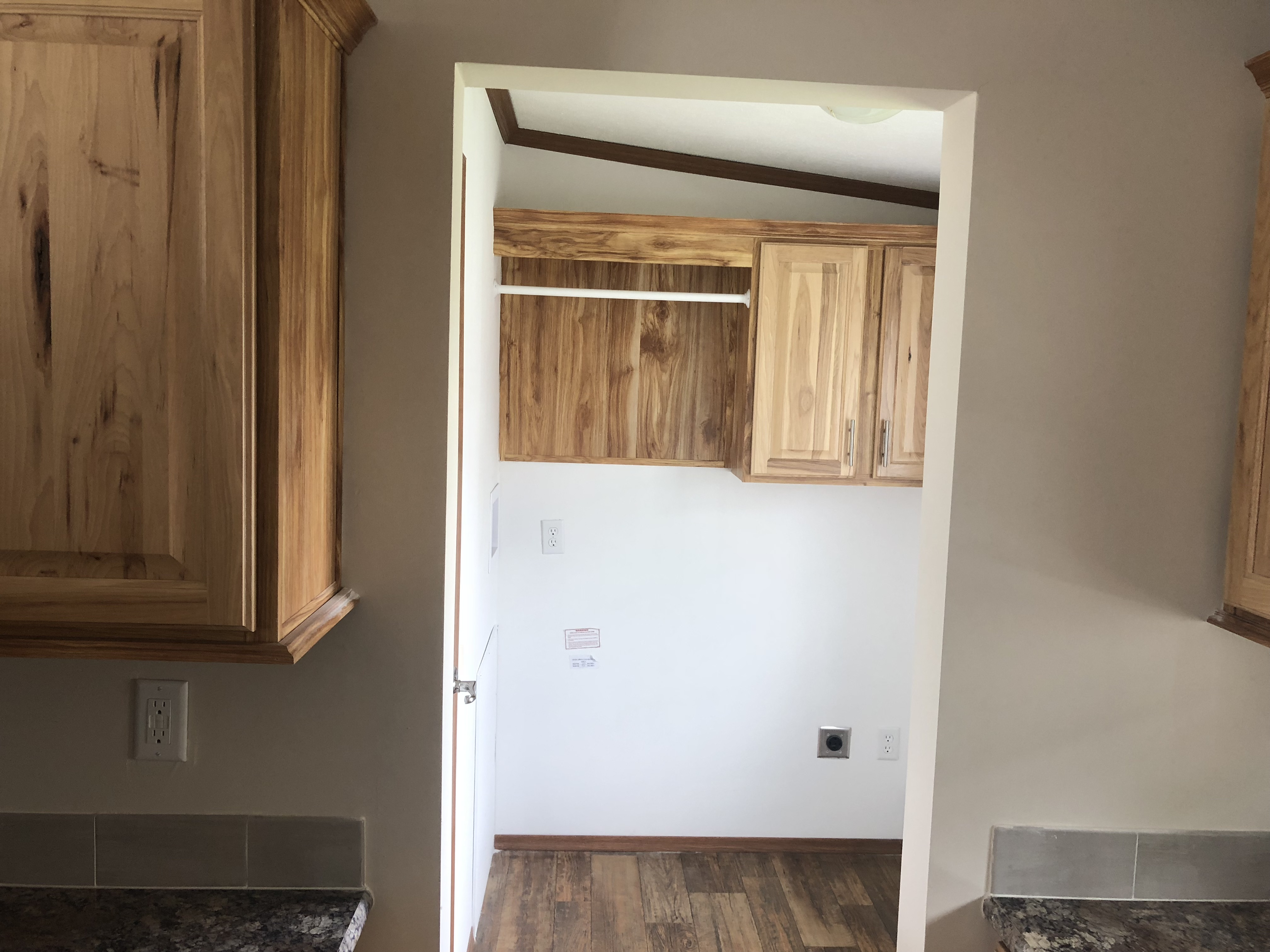 Utility Room With The Washer Dryer Cabinets