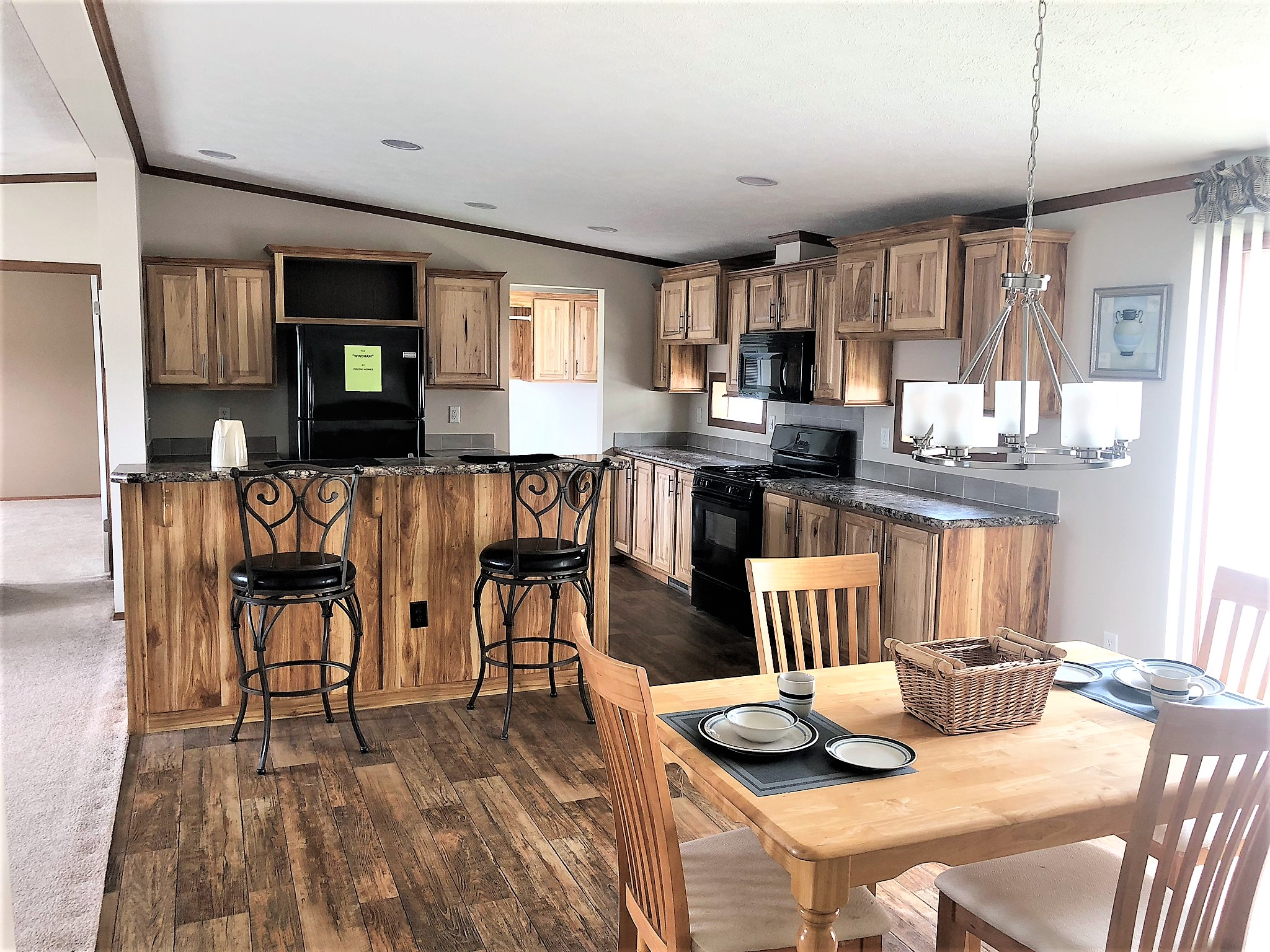 View Showing The Kitchen With Hickory Cabinets