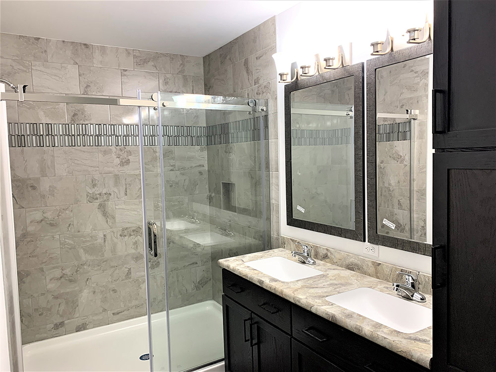 Ceramic Shower With  Glass Barn Door Application And Undermount Sinks