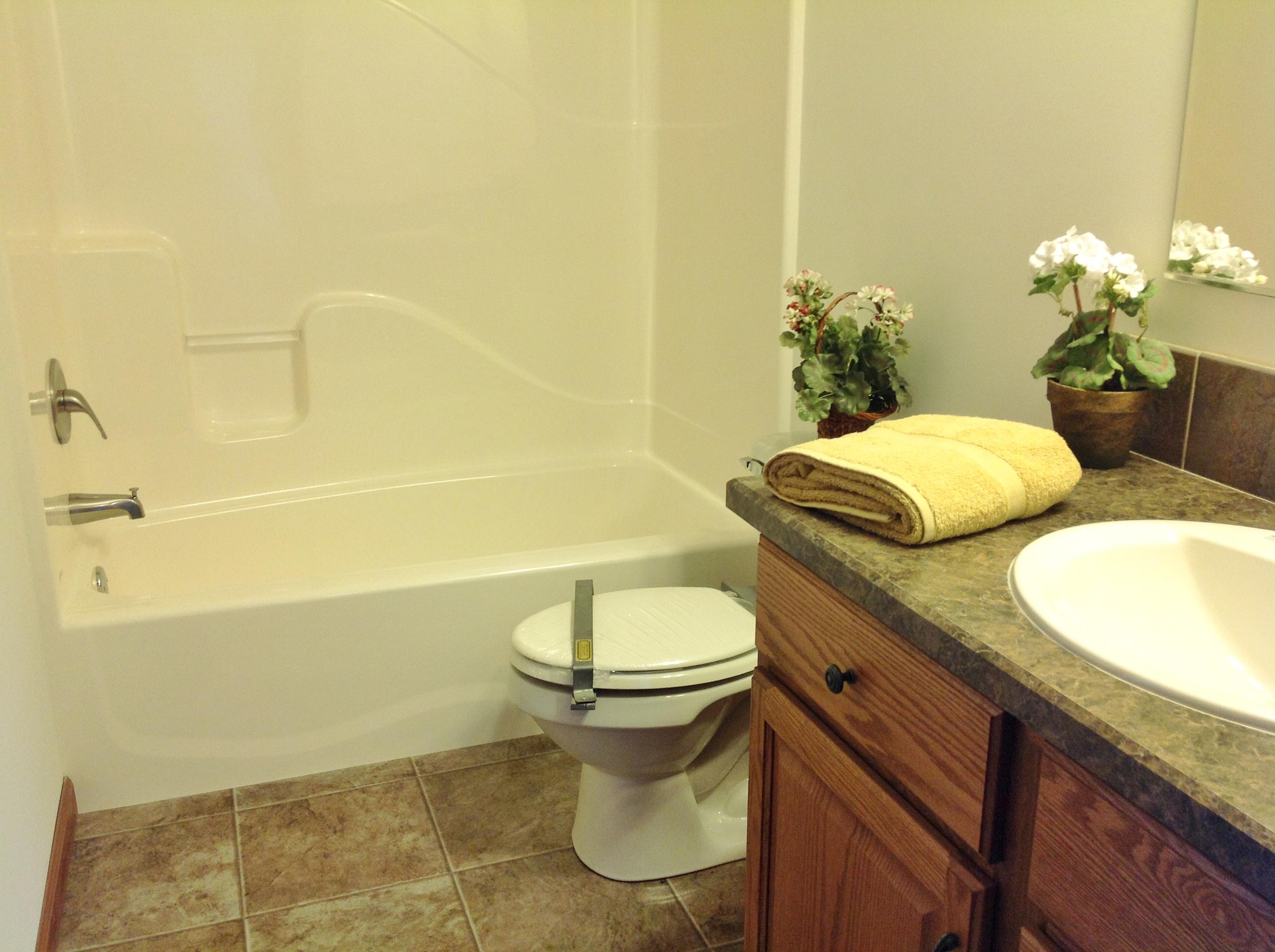 Hall bath off utility room.