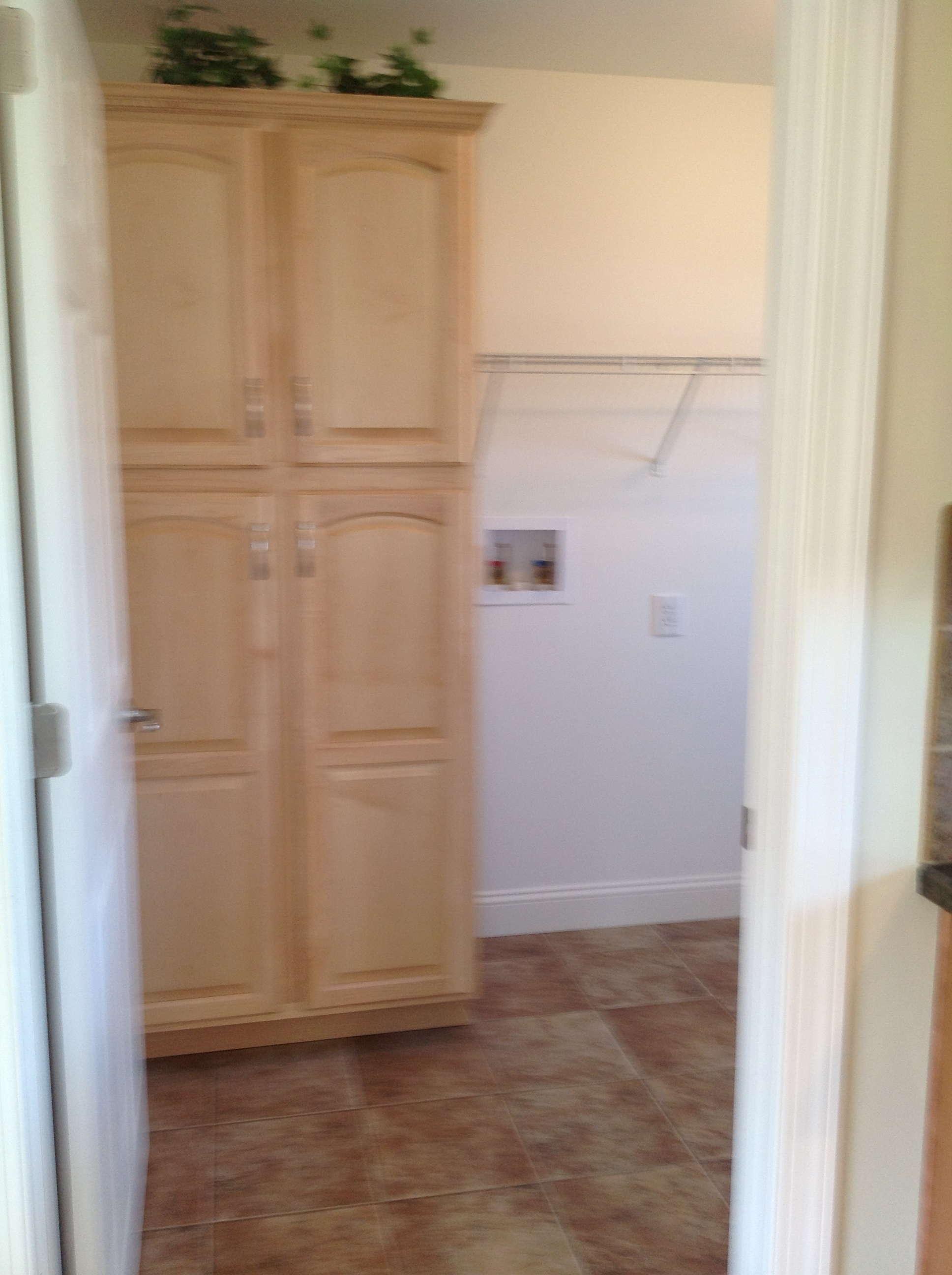 Optional pantry cabinet in the utility