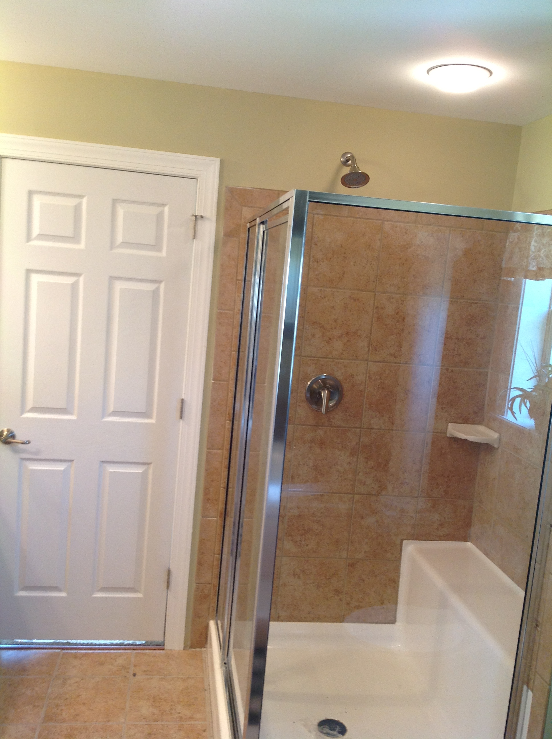 Optional ceramic shower with seat.