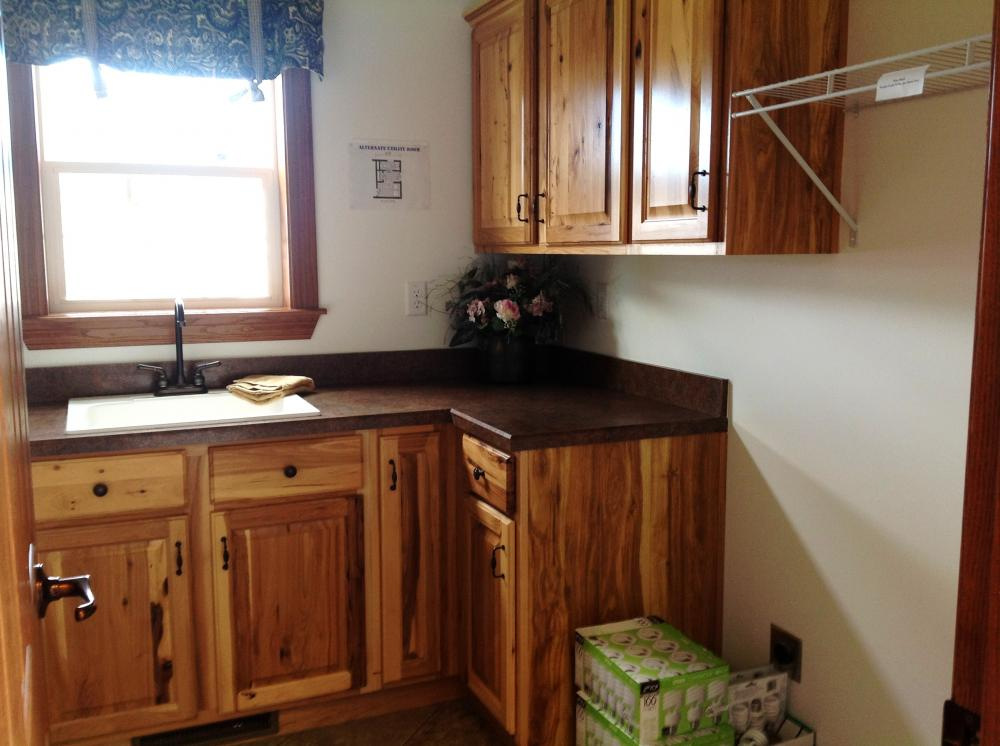Utility room cabinets and sink.