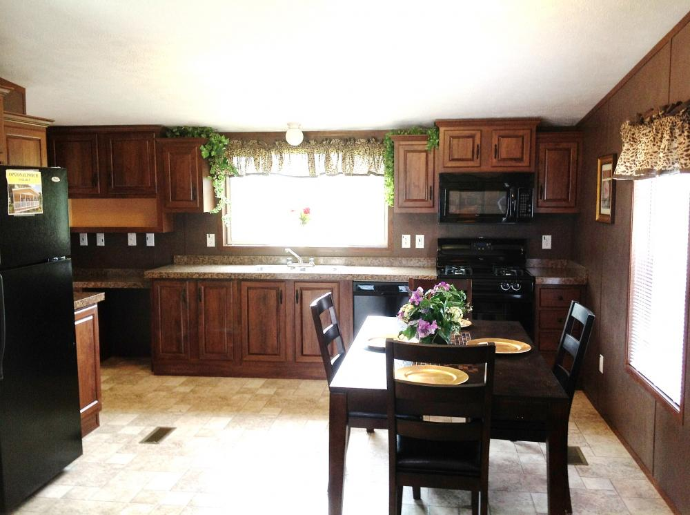 The kitchen with a picture window over sink