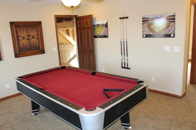 Off the game room is attic space.