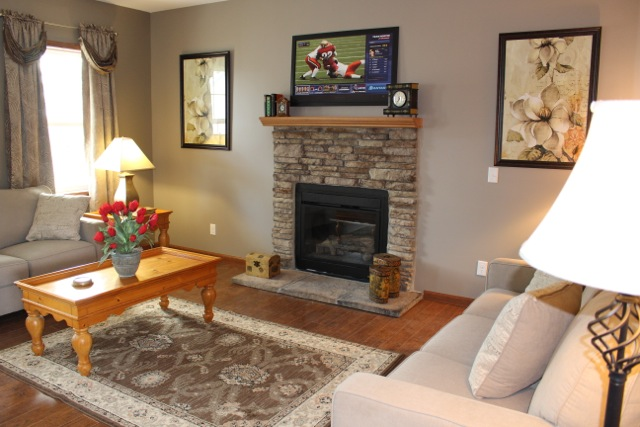 Shot of the living room with optional fireplace.