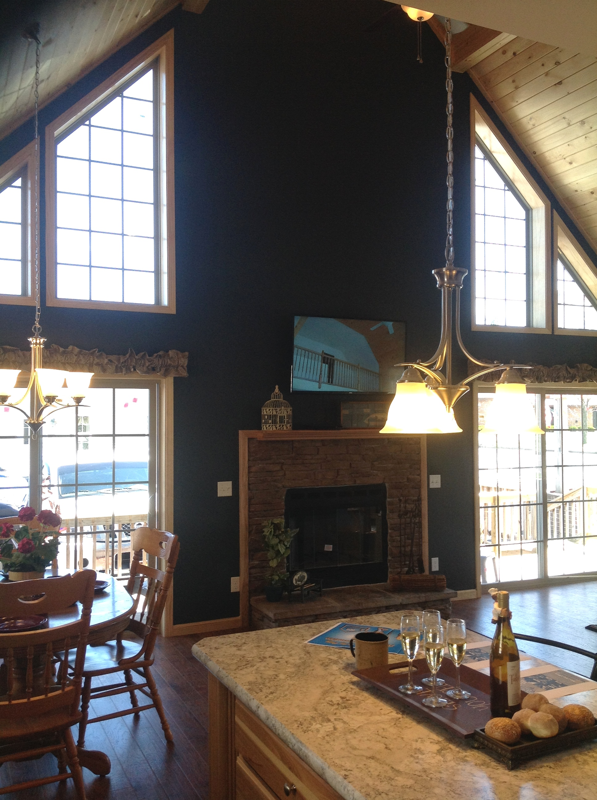 Trapozoid windows, bump out fireplace and sliding glass doors.