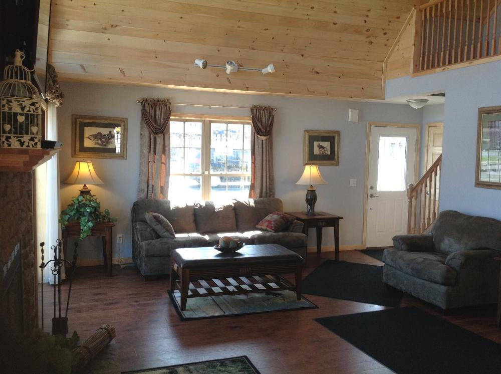 Pine finish in vaulted loft and laminate floors throughout.